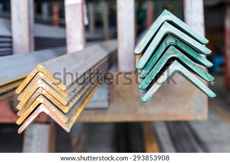 Close up stacked of angle steel in factory - stock photo