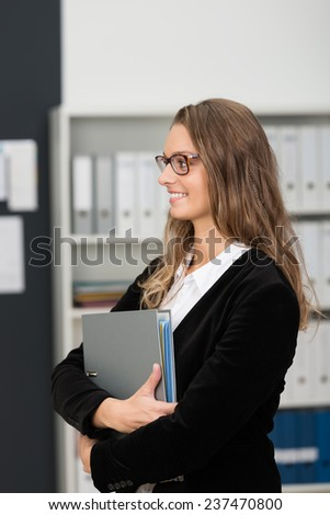 Close up Standing Blond Office Woman in Side View Holding Reports in Gray Folder While Looking at the Left Frame. - stock photo