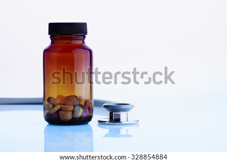 Close up Stethoscope and pill over white background
