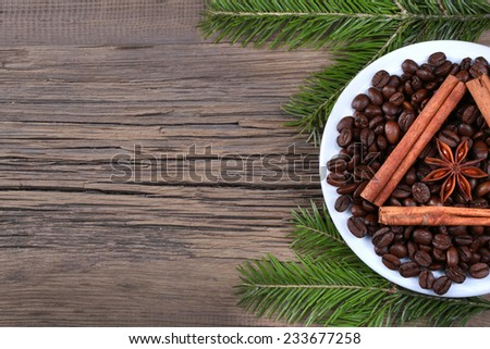 close-up still-life of cinnamon, star anise and coffe on magic Christmas holiday on background wooden boards studio - stock photo