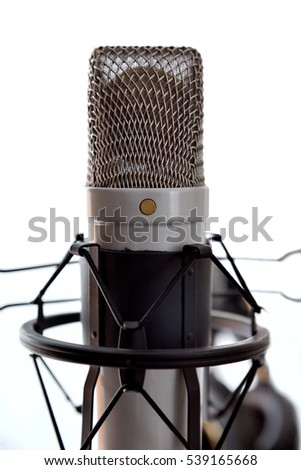 Close up studio condenser microphone with anti-vibration mount isolated white. Front view. Vertical composition