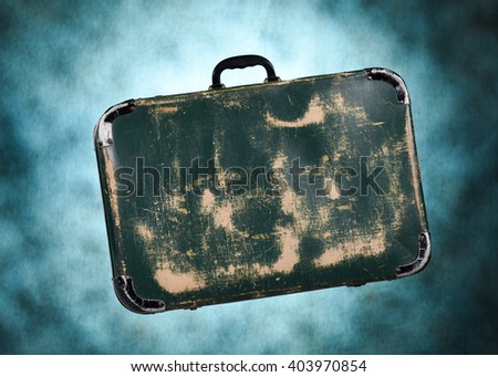 close up studio image of an old fashioned vintage leather travel suitcase - stock photo