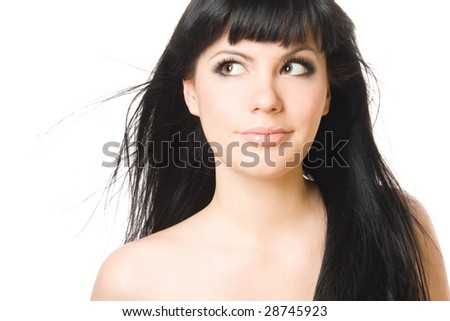 Close-up studio portrait of a sexy young smiling woman, isolated on white background