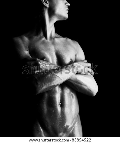 Close-up studio portrait of a young muscular nude man - stock photo