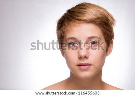 close up studio portrait of beautiful blond teenage girl.