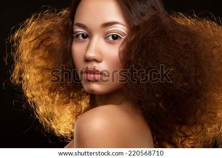Close-up studio portrait of beautiful woman - stock photo