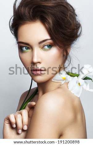 Close-up studio portrait of beautiful woman with bright make-up - stock photo