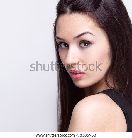 Close up studio portrait of sensual young woman