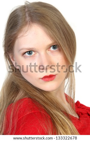 Close-up studio portrait of young beautiful woman in red on white background - stock photo