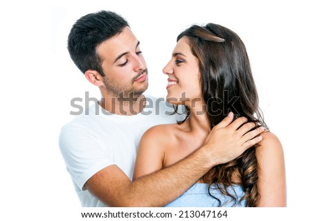 Close up studio portrait of young couple looking at each other.Isolated on white background. - stock photo