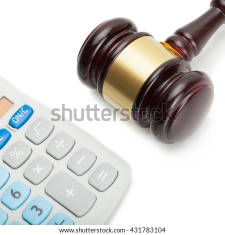 Close up studio shot of a judge's gavel next to neat calculator - stock photo