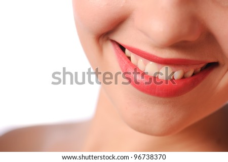 close up studio shot of woman's red lips
