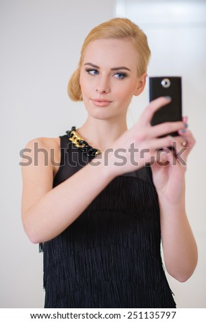 Close up Stylish Pretty Young Woman in Black Sleeveless Dress Calling on Phone.