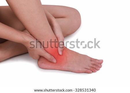 Close up suffering male pain in ankle isolated white background.