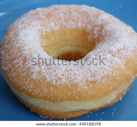 close up, Sugar Donut with on blue background             - stock photo