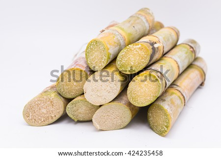 Close up sugarcane on white  background.brown sugar in wooden spoon.  brown sugar .brown sugar. brown sugar from sugar cane. brown sugar.natural brown sugar.brown sugar. - stock photo