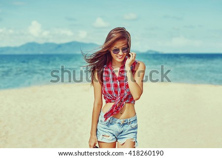 Close up summer fashion portrait of beautiful young sexy woman posing on the beach - stock photo