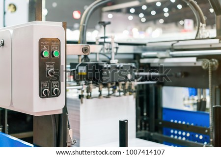 Close up switch and push button at control panel of modern and high technology of automatic publication or printing machine