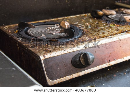 Close up switch of old broken dirty gas stove in kitchen. - stock photo