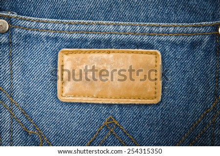 Close up tag on jeans background texture, blue jeans