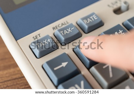 Close up tax button on calculator. soft focus. Concept of tax, taxes, tax calculation,