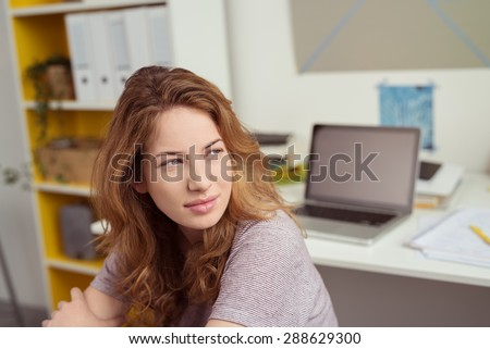 Close up Teen Girl at her Study Area Inside the House, Looking Into Distance in a Pensive Facial Expression. - stock photo