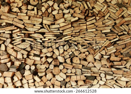 Close-up texture of a pile of wood logs and board - stock photo