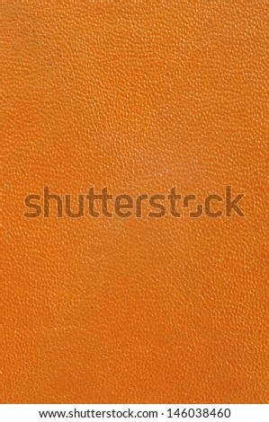 Close up texture of brown or orange leather for use as Background