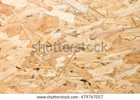 Close up texture of oriented strand board (OSB), Wood board made from piece of wood