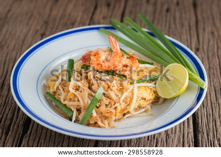 "close-up Thai Fried Noodles ""Pad Thai"" with shrimp and vegetables"