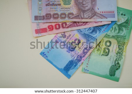 Close up Thai money in one thousand type banknotes with calculator isolated on white background