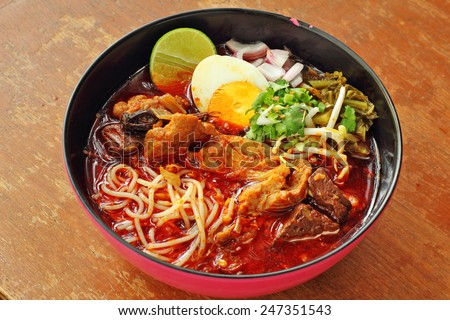 close up thai northern spicy pork noodle in cup