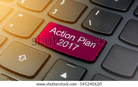 Close-up the Action Plan 2017 button on the keyboard and have Pink color button isolate black keyboard
