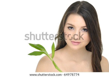 Close up the attractive girl with green bamboo - stock photo