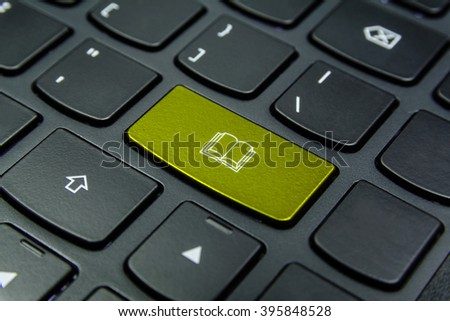 Close-up the Book symbol on the keyboard button and have Yellow color button isolate black keyboard