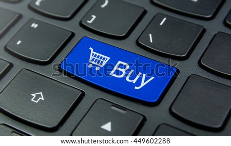 Close-up the Buy with Shopping Cart  symbol button on the keyboard and have Blue color button isolate black keyboard - stock photo