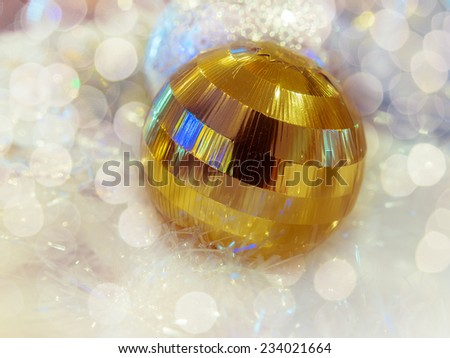 Close-up the decorative golden Christmas ball with defocused bokeh lights. : filtered process  - stock photo