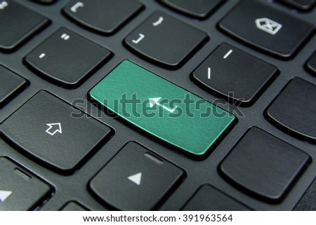 Close-up the Enter symbol and have Aquamarine color button isolate black keyboard