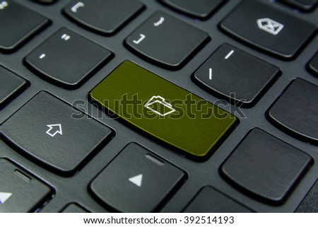 Close-up the Folder symbol on the keyboard button and have Olive color button isolate black keyboard