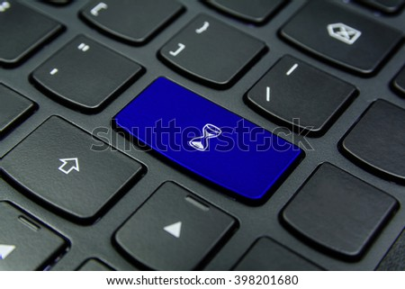 Close-up the Hourglass, Sand Glass, Sand Clock symbol on the keyboard button and have Blue color button isolate black keyboard