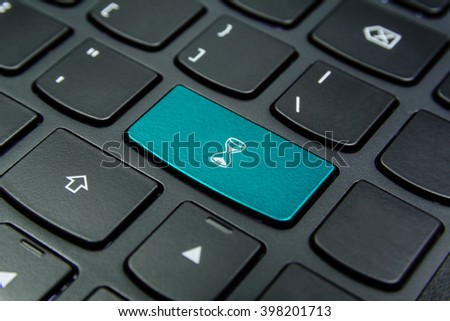 Close-up the Hourglass, Sand Glass, Sand Clock symbol on the keyboard button and have Cyan color button isolate black keyboard