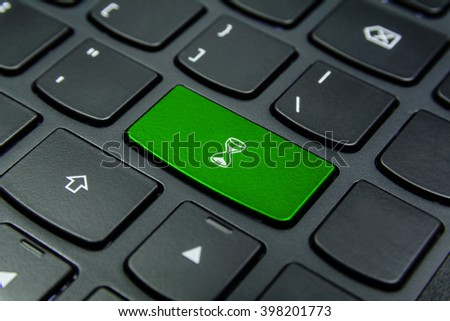 Close-up the Hourglass, Sand Glass, Sand Clock symbol on the keyboard button and have Lime color button isolate black keyboard