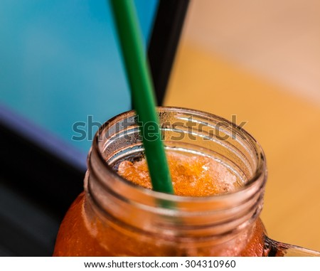 Close up the mouth of the glass lemon tea. - stock photo