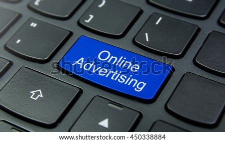 Close-up the Online Advertising button on the keyboard and have Blue color button isolate black keyboard