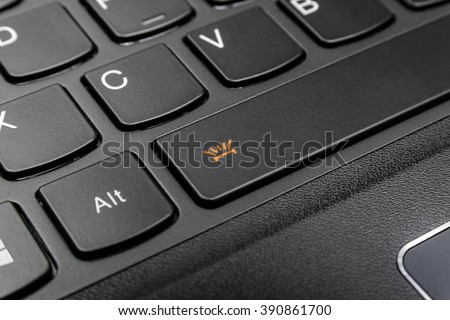 Close up the orange symbol of black keyboard for open light under the button for use in night time (Space bar) - stock photo