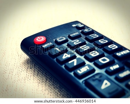 Close up the red power button on the TV remote control