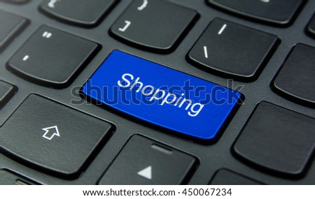 Close-up the Shopping button on the keyboard and have Blue color button isolate black keyboard