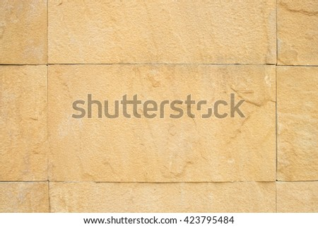 close up, the surface of big stone Cladding brick wall, beautiful brick wall, Stone Wall Cladding is dirty white. background texture - stock photo