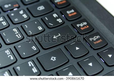 Close up the symbol button (enter button) on black keyboard of desktop, laptop, computer (Thai keyboard) - stock photo