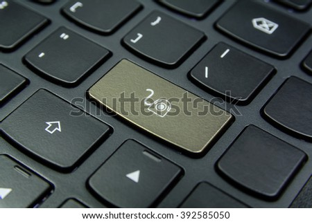 Close-up the Webcam symbol on the keyboard button and have Wheat color button isolate black keyboard